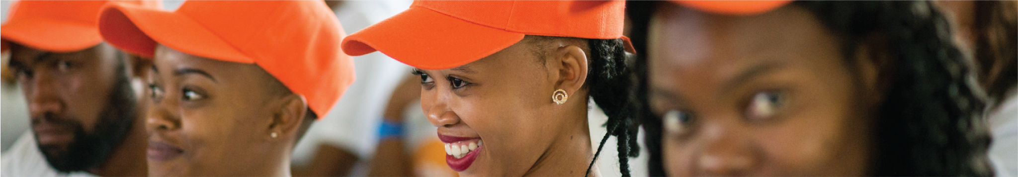 Youth wearing orange hat